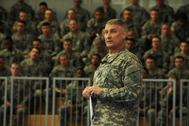 """Sgt. Maj. of the Army Raymond F. Chandler III tells Soldiers to always be a professional, and says a Soldier should """"live the Warrior ethos,"""" during a Town Hall meeting at the Grafenwoehr Physical Fitness Center in Grafenwoehr, Germany, March 6."""
