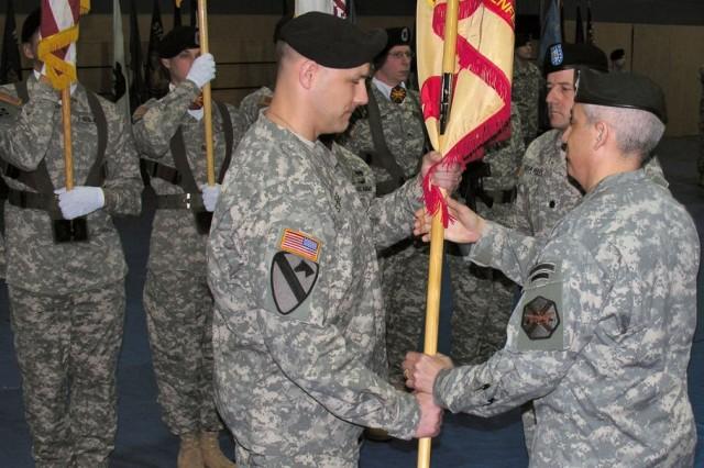 Lt. Col. John J. Strange Jr. receives the guidon from Col. James E. Saenz, commander, USAG Grafenwoehr, assuming command of USAG Hohenfels, March 1.