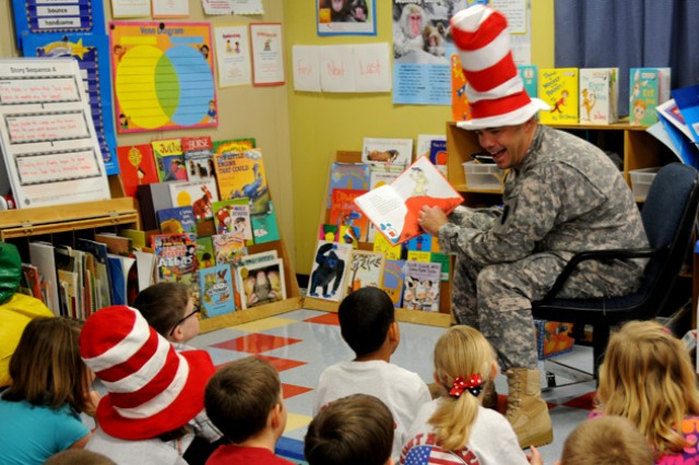 Maj. Britt Reed reads a Dr. Seuss book to children during a celebration of Dr. Seuss' birthday at Fort Rucker Primary School Mar. 2.