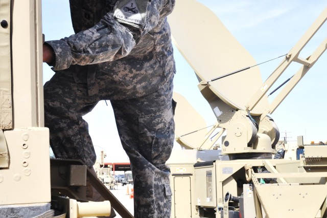 Capt. Charles G. Feher, communications officer for the 2nd Brigade, 1st Armored Division, works with a Warfighter Information Network-Tactical Increment 2 Tactical Communications Node, Feb. 29, 2012, at Fort Bliss, Texas.