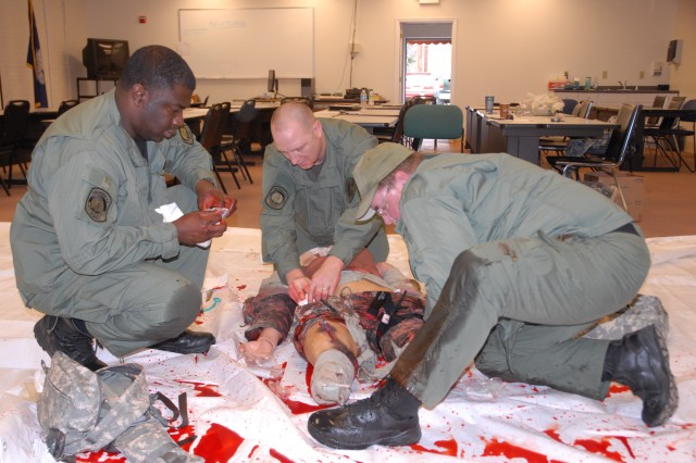 Officers from the Columbia Police Department SWAT team practice their life-saving skills on an interactive mannequin. The training was provided by a Fort Jackson combat lifesaver instructor.