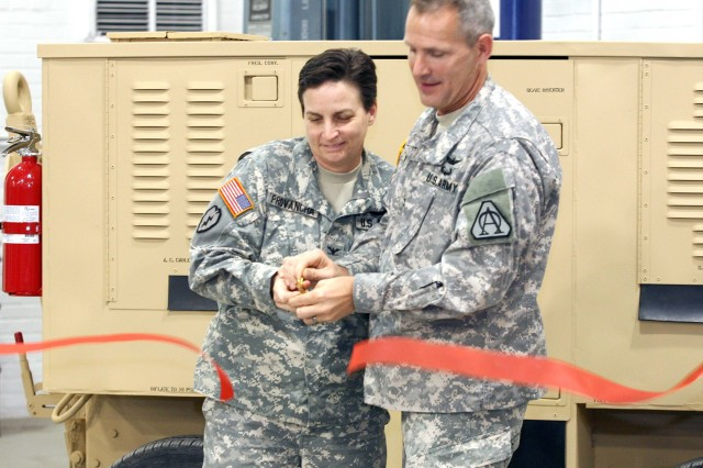 Col. Cheri A. Provancha, Letterkenny Army Depot Commander and Col. Anthony Potts, Program Manager, Aviation Systems cut the ribbon recognizing the successful completion of the First Article Testing for the Aviation Ground Power Unit, Build to Assemble.