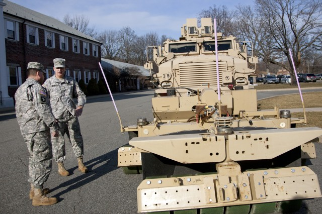 Brig. Gen. Jonathan A. Maddux, facing camera, discusses the Self-Protection Adaptive Roller Kit (SPARK) with Brig. Gen. Peter DeLuca, commandant of the U.S. Army Engineer School.