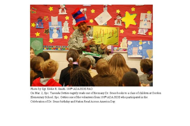 Spc. Tasonda Getties eagerly reads one of the many Dr. Seuss books to a class of children at Gordon Elementary School.