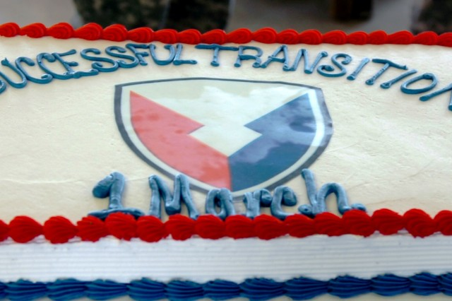 This cake symbolizes successful transition of contractors deploying/redeploying through the CONUS Readiness Center at Fort Benning, Ga., to Camp Atterbury, Ind. The changed stemmed from Headquarters, Department of the Army Executive Order 267-11. (Photo by Sgt. Will Hill)
