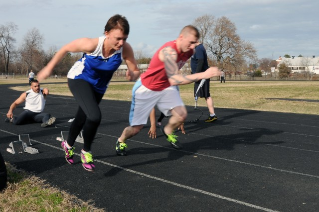 Staff Sgt. Krisell J. Creager-Lumpkins of Fort Carson, Colo. (left) takes off the blocks at the Warrior Games clinics at Fort Meade, Md.