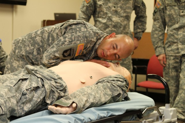 TRIPLER ARMY MEDICAL CENTER, Hawaii --  Hawaii National Guard Capt. Mike Kennedy, health services, plans, operations, intelligence, security, and training officer, 93rd Civil Support Team, listens to the  patient simulator mannequin's breathing during a mock patient assessment, here, Feb. 23, as part of TAMC's Medical Education and Demonstration of Individual Competence course.