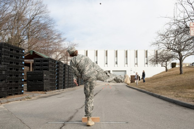 Pfc. Airryn Hesse tosses a grenade toward a target March 8, 2012, during Soldier performance testing being done by the U.S. Army Research Institute of Environmental Medicine at Natick Soldier Systems Center.