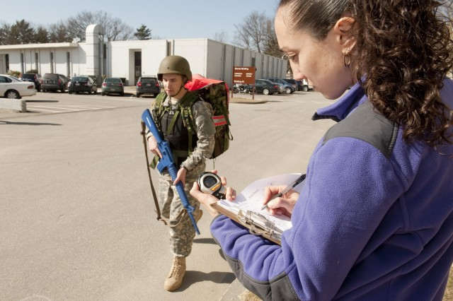 Leila Walker, a physiological research technician at the U.S. Army Research Institute of Environmental Medicine at Natick Soldier Systems Center, records Soldiers' times March 8, 2012, during a two-mile ruck march, part of Soldier performance testing.