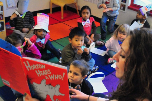 "PRESIDIO OF MONTEREY, Calif. -- Teacher Katie O'Donnell kicks off a day of Dr. Seuss readings for her preschool group with ""Horton Hears a Who!"""