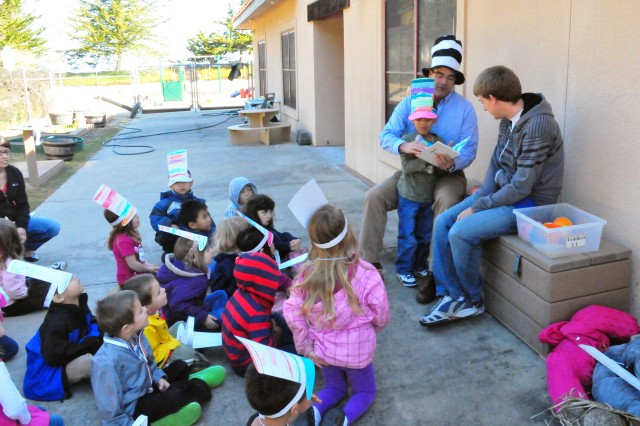 PRESIDIO OF MONTEREY, Calif. -- Director for Family and Morale, Welfare and Recreation Bob Emanuel captures the attention and imaginations preschoolers during Read Across America at the Monterey Road Child Development Center March 5.