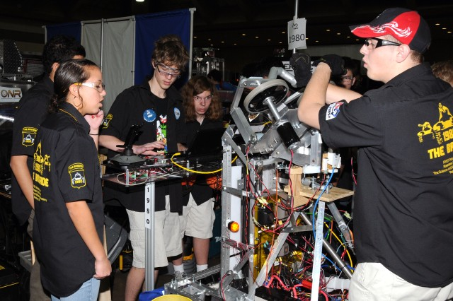 The Brigade, or Team 1980, one of two Army-sponsored teams, make last minute tweeks on their robot before the competition in Baltimore.