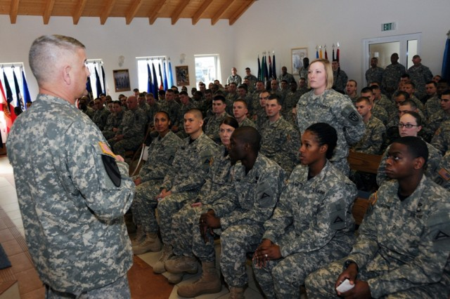 Cpl. Trish Becker, a medic with the 615th Military Police Company, asks Sgt. Maj. of the Army Raymond F. Chandler III a question during a forum at Rose Barracks, March 6. Chandler, along with his wife, Jeanne, visited several European garrisons last week.
