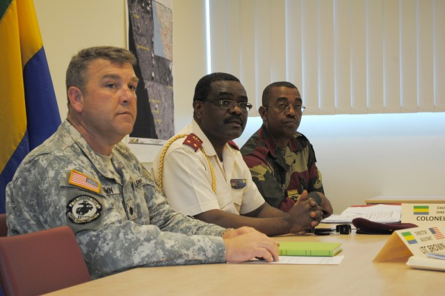 Task Force Commander Lt. Col. John E. Brown, a member of 66th Troop Command in Jackson, Miss.; Brig. Gen. Romaen Tchoua, deputy director of Gabonese Military Health Services; and Col. Jean Essono, Medical Accord Central 12 exercise commander, listen to staff updates during Medical Accord Central 12 in Libreville, Gabon. Medical Accord Central 12 is a joint military medical exercise designed to enhance readiness capabilities of U.S. and Gabonese Army Soldiers.