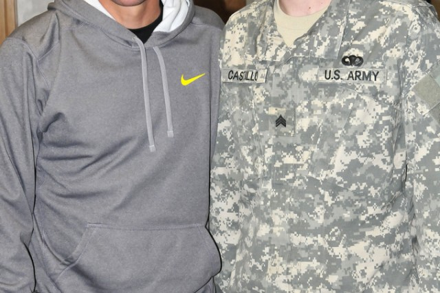 Sgt. Alan Castillo, intelligence analyst, poses with Lance Armstrong during Armstrong's visit to Joint-Base Myer Henderson Hall, Va, in March of last year. A few months later, Castillo was re-diagnosed with colon cancer. Currently, Castillo is assigned to the Fort Sam Houston, Texas Warrior Transition Unit where he receives treatment for stage four metastatic colon cancer at the University of Texas MD Anderson Cancer Center. (U.S. Army photo by Devin Kornaus)