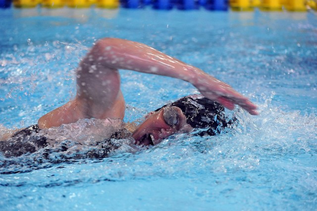 Capt. Mickey Kelly competes in the swimmng portion of the Modern Pentathlon World Cup in Charlotte, N.C., March 10, 2012.