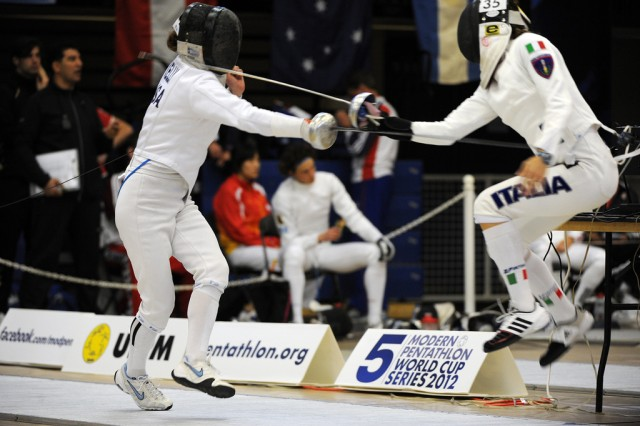 Capt. Mickey Kelly (left) competes in the fencing portion of the Modern Pentathlon World Cup in Charlotte, N.C., March 10, 2012.