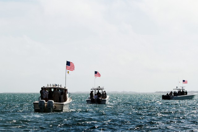 """Boats from the U.S. Army's Special Forces Underwater Operations School, based out of Key West, Fla., head back to shore following a March 10 ceremony where Army and Navy personnel supported the Family of Dr. Christian Lambertsen in committing Lambertsen's ashes to the Atlantic Ocean. Lambertsen, a World War II veteran who served in the Office of Strategic Services, is known as the """"father of military combat diving."""""""