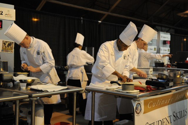 Soldiers with the Fort Stewart, Ga., Culinary Team compete in the Student Team Skills Competition in Fort Lee, Va., March 2, 2012. Every branch of the military competed in various culinary categories during the 37th Annual Military Culinary Arts Competition.