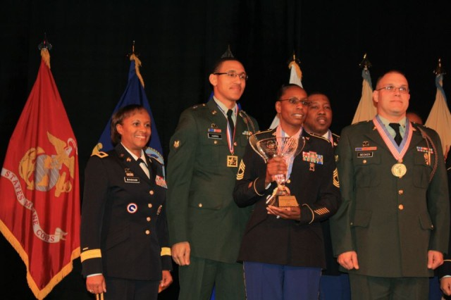 Master Sgt. Verna Bellamy, Third Infantry Division food service noncommissioned officer in-charge, accepts the Installation of the Year award with team members from Fort Stewart, Ga., March 9,2012, at Fort Lee, Va.