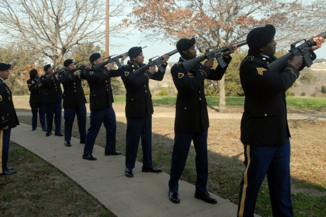 FORT HOOD, Texas--Soldiers fire a 21-gun salute in honor of Spc. Michael Bailey at a memorial ceremony in his honor on Fort Hood, Texas, Feb. 9.