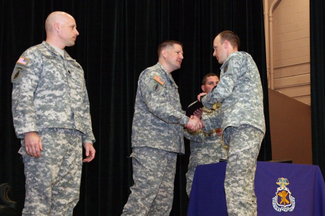 More than 90 Soldiers graduated from the Civil Affairs Officer Qualification and Specialist Qualification Course and entered the ranks of the U.S. Army's Civil Affairs Regiment on March 2 during a graduation ceremony in Fort Bragg's John F. Kennedy Auditorium.