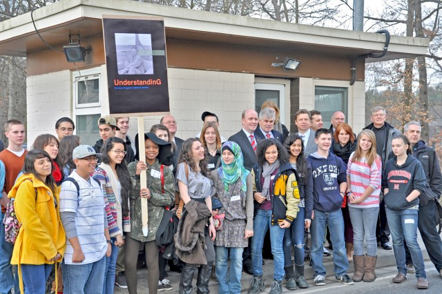 German and American students and officials gather around the landmark at the former Gateway Gardens Housing Area which served Rhein-Main Air Base, Germany.