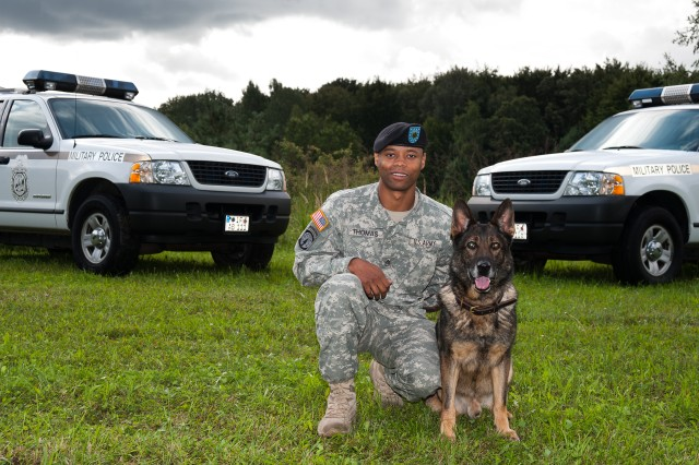 Staff Sgt. Moreno Thomas, a Military Working Dog handler, is pictured here with Brando, a Military Working Dog who was euthanized due to cancer.  Brando was honored in a memorial ceremony March 9, 2012, at the chapel on Panzer Kaserne in Stuttgart, Germany.