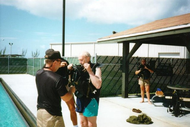Dr. Christian Lambertsen (right) prepares to conduct an underwater dive at the U.S. Army's Special Forces Underwater Operations School in Key West, Fla. in the mid-1990s. At the time of the dive, Lambertsen was in his mid-80s. Lambertsen, a World War II veteran and Office of Strategic Services operational swimmer, invented the Lambertsen Amphibious Respiratory Unit - the precursor to modern SCUBA equipment - while attending medical school in 1941.