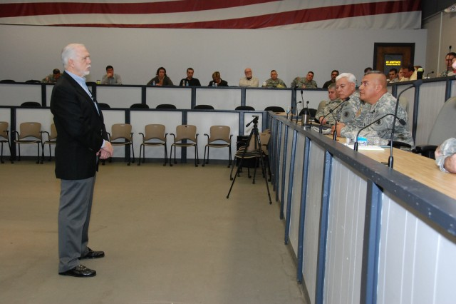 Dr. Thomas McNish (left), a former Air Force prisoner of war from September 1966 to March 1973, speaks at Army South's reintegration training Dec. 14 about his experiences as a Vietnam POW.