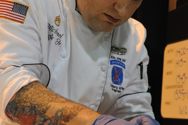 U.S. Army Staff Sgt. Michael Bogle with the Fort Drum Culinary Team sets plates during Live Pastry Challenge in Fort Lee, Va., February 29, 2012. All military branches competed in several categories during the 37th Annual Military Culinary competition.
