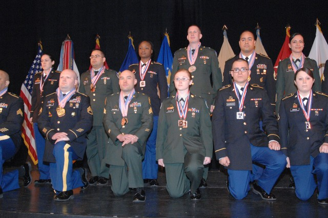 Members of the Fort Drum Culinary Arts Team won a total of 36 medals in the 37th U.S. Army Culinary Arts Competition at Fort Lee, Va. Brig. Gen. Gwen Bingham, left, U.S. Army quartermaster general, presented the medals. Team members are, first row from left, Sgt. David Allen, one silver medal, one bronze; Staff Sgt. Michael Bogle, three gold, two silver, two bronze; Sgt. David Cantwell, two silver, one bronze; Spc. Shawnah Collett, two bronze; Spc. Jaime Contreras, two silver, one bronze; and Pfc. Kelsee DeMass, one silver, one bronze. Second row, Pfc. Kara McKittrick, one bronze; Spc. David Navarro, two silver, two bronze; Spc. Markee'shia Neal, two bronze; Sgt. Daniel Parks, one silver, one bronze; Staff Sgt. Carlos Quiles, one gold, two silver; Spc. Iris Trejo, two bronze, and Sgt. Marco Yapias, one silver, one bronze.