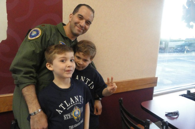 Maj. Savan Becker, a Fort Meade Air Force Reservist, poses with his sons, Tristan and Kiran. Becker is a finalist in Space Race 2012, a Facebook-hosted competition sponsored by the Seattle Space Needle to win a suborbital space flight.
