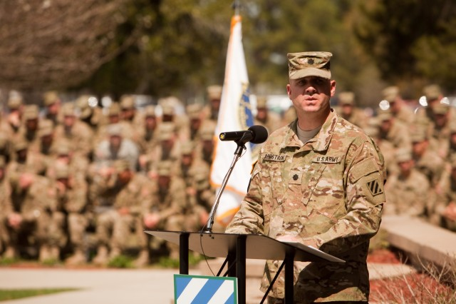 Lieutenant Colonel Charles Armstrong, commander, 1/64th Armor, speaks to Soldiers and Families, during the Desert Rogues' Color Casing ceremony in preparation for the unit's upcoming deployment to Afghanistan, held at Fort Stewart's Marne Garden, March 14.