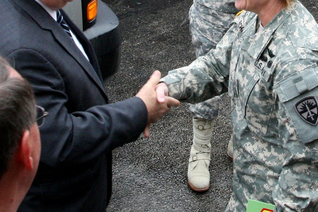Under Secretary of the Army Joseph Westphal meets with Brig. Gen. Laura Richardson, commanding general Operational Test Command March 9, 2012, during his visit to Fort Hood, Texas.