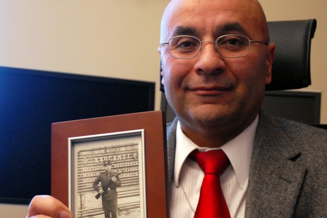 Sr. Mahir Ibrahimov, Army senior culture and foreign language adviser, holds a copy of a photo of himself as a cadet in the Soviet army in 1974.