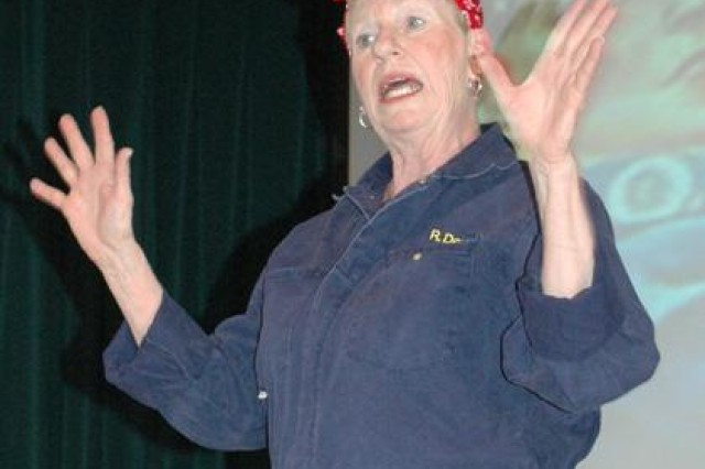 Charlene Perry of the APG Theater Group performs as Rosie the Riveter, a cultural icon representing women who worked in factories during World War II , during the 22nd annual Federal Women's Program training conference March 8. - Photo by Rachel Ponder