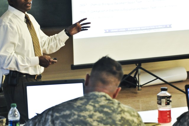 Harry Mosby, a logistics analyst with Army Materiel Command's Logistic Support Activity, Redstone Arsenal, Ala., teaches National Guard Soldiers as part of Redistribution Property Assistance Team training, March 15, at Camp Shelby, Miss.