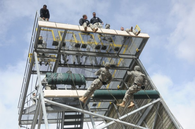 Students rappel off a 40-foot tower as their instructors watch for technique and ability.