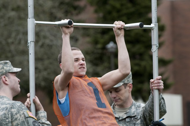 "Giavonee Rowe, Federal Way High School, competes in the pull-up bar challenge during the ""Lute Fair"" at the Pacific Lutheran College March 9. Junior Reserve Officer Training Corps teams traveled from across the state of Washington to attend the annual event. The students competed in an Army Physical Fitness Test as well as several other challenges. The students were presented with the opportunity to talk with representatives from military branches and colleges within the region."