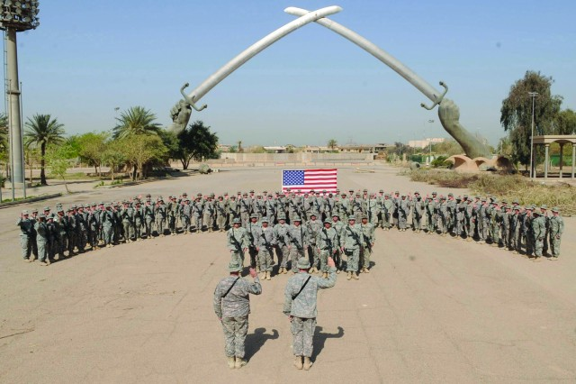 Paratroopers assigned to 5th Squadron, 73rd Cavalry Regiment, 3rd Brigade Combat Team, 82nd Airborne Division, recite the oath of re-enlistment April 23, 2009, during a ceremony in Baghdad. The ceremony marked the squadron meeting its retention goals.