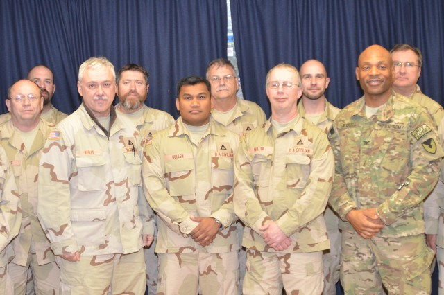 Col. Michel M. Russell, Sr., commander of 401st Army Field Support Brigade (front row, third from right), Mark W. Akin, deputy to the commanding officer, 401st AFSB (front row, far left, and Theresa A. Smith, Joint Munitions Command senior command representative to the 401st AFSB (front row, far right), pose with the members of Operation Ammunition Clean Sweep 2012 who will support draw-down efforts, retrograde operations, combat readiness and explosives safety with the goals of removing and reclassifying the unserviceable or unsafe ammunition at each location and educating the service members on the proper way to store and handle munitions.  Kyle Voelcker (back row, far right) was the JMC SCR at the 401st AFSB for six months last year. Five of OACS 2012 team members supported OACS 2011.