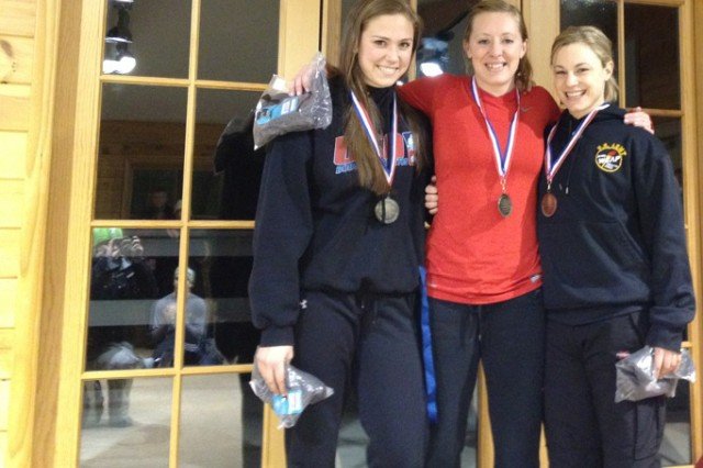 Spc. Megan Henry (right), HHC 854th Engineer Battalion, 411th Engineer Brigade, won the 2012 U.S. National Skeleton Championship in the women's category at Mt. Van Hoevenberg, March 4, 2012. The 24-year-old intelligence analyst captured the gold medal by posting the fastest start and finish times in all four heats.