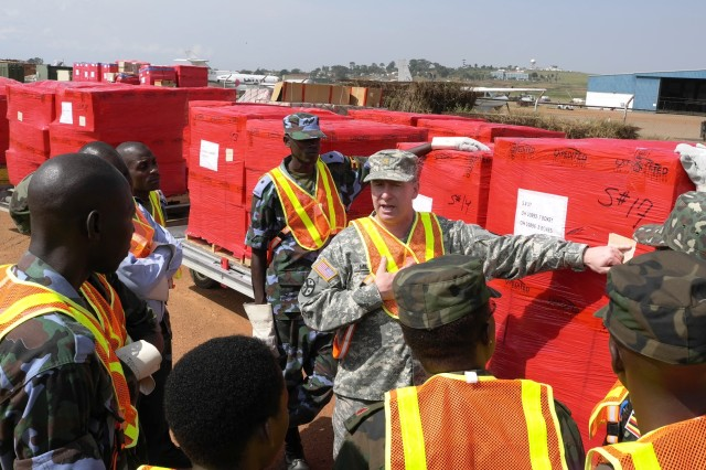 Maj. Tony Miller of the Tennessee National Guard explains shipping labels on outbound cargo during a recent training event where Africa Deployment Assistance Partnership Teams traveled to Uganda to conduct Phase I training for 17 Army and 10 Air Force members of the Uganda People's Defense Force.