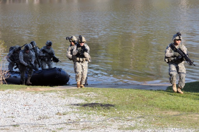 Soldiers of the Ranger Training Brigade show their boat infiltration techniques to congressional staffers March 16, 2012, at Fort Benning, Ga.