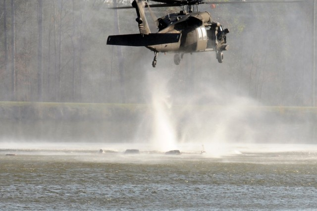 A helicopter drops an explosive charge during a Ranger Training Brigade demonstration at Fort Benning, Ga., March 16, 2012.