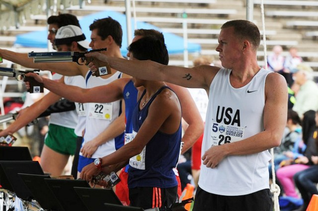 Spc. Dennis Bowsher, a member of the U.S. Army World Class Athlete Program, fires a laser-pistol as part of the five-sport Modern Pentathlon competition in Rio de Janeiro, Brazil, March 16-17, 2012.