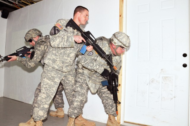 "As part of their treatment for Traumatic Brain Injury, Sgt. 1st Class Jeremy Ricketts (left), Spc. Jeffrey Friberg (center) and Staff Sgt. Richard Durgin practice ""clearing a room"" drills during simulated combat skills training at the Warrior Skills Training Center at Fort Hood, Texas, March 9, 2012. They were the first to go through simulation training as part of the Warrior Readiness Assessment program at Carl R. Darnall Army Medical Center's  Traumatic Brain Injury Clinic."