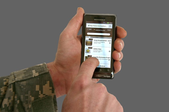 On his personal phone, a Soldier previews publicly-facing apps approved by the Army.