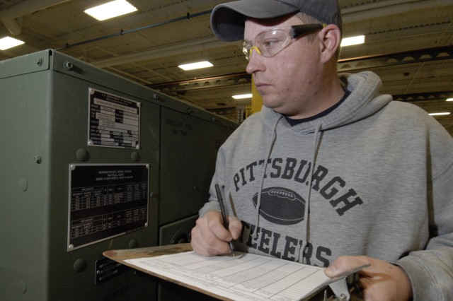 General Equipment Mechanic James Yoder verifies serial numbers for shipment while working in the depot's Mobile Electric Power Branch.  In the generator area, branch employees assemble and mount various types of generators and trailers. The branch also modifies generators through a testing and overhaul process, helping reduce the risk of failure when put into a field environment.  On the set assembly line, branch employees repair over 1,200 sets of equipment, ranging from 10 to 25 items in each set.  On average, employees complete four generators from Unmanned Air Vehicle systems per month. Total overhauls and units tested is nearly 500. The branch also repairs and rebuilds components for the AN/TRC-170 Radio Terminal Set.  Future plans include becoming certified to rebuild diesel engines and associated equipment, and processes including the advanced diagnostics of the engine and electrical system.